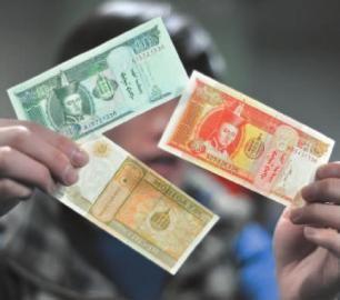 3张蒙古国纸币共价值人民币5分钱 新文化记者吴廷摄